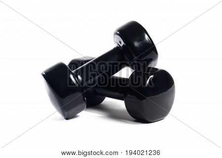 Two black dumbbells on an isolated background In a random order