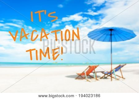 IT'S VACATION TIME message on blurred beach background