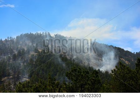 Smoldering Smoky Forest Fire in the Mountains