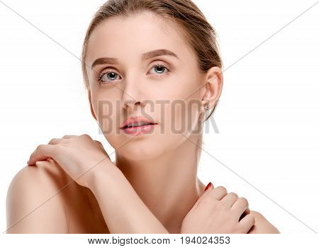 pretty woman touching her perfect smooth skin