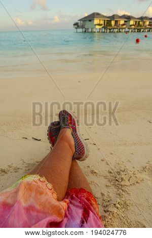 Tanned legs at the end of a sunshiney day in the tropics