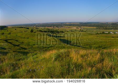 View of big space from above where hills agricultural fields and nbolshy a row located freely on this beautiful place are visible. Kuban Krasnodar Krai Russia.