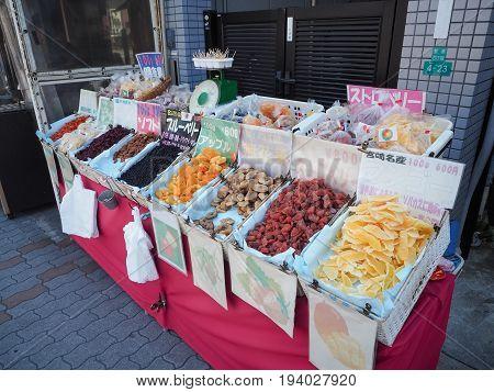 OSAKA CASTLE: OSAKA, JAPAN - APRIL 3, 2017: Dried sweet fruits for sale at street market in Osaka, Japan