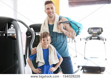 Dad and son spending time in gym