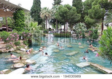 Antalya, Turkey - May 28 2017: A popular tourist attraction, rejuvenating pool Cleopatra in the ancient city of Hierapolis, Pamukkale, always full of tourists.