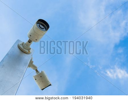 Closed-circuit television or CCTV Security camera on blue sky background