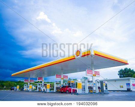 Nakhon Si Thammarat Thailand - July 2 2017: Shell gas station blue sky background. Royal Dutch Shell sold its Australian Shell retail operations to Dutch company Vitol in 2014