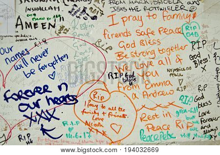 LONDON UK - JULY 6 2017: Memorial messages written on a wall close too the Grenfell Tower block of council flats in which at least 80 people are feared to have died in a fire in Kensington West London.