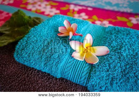 White Tiare Flowers On A Towel