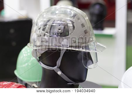 Turquoise Safety helmet on a shelf; Working Hard Hat;Personal Protection Equipment PPE
