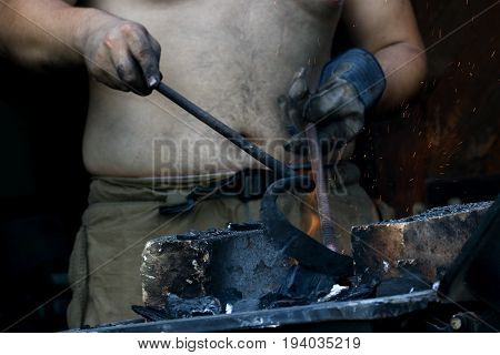 Blazing furnace and the blacksmith fire with coal