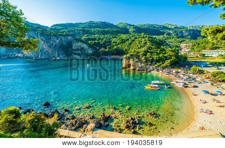 Beautiful beach and boat in Paleokastritsa Corfu island Greece