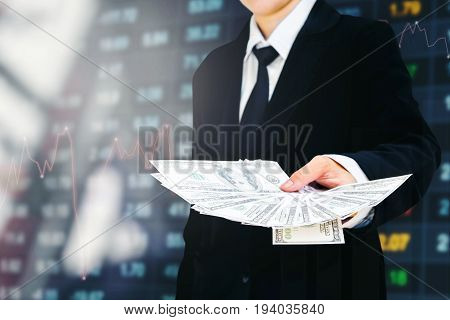 Businessman Holding Money Us Dollar Bills Business Financial Concept Forex Graph Of Stock Market On
