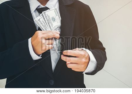 Business Man Keeping Money Dollar Bills. Saving Concept