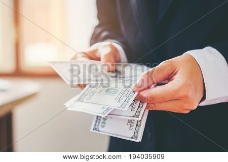 Business Man Hands Counting Us Dollar Bills  Saving Concept