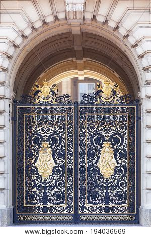 Buckingham Palace decorative metal golden gate to the courtyard London United Kingdom. Palace is the London residence and administrative headquarters of the reigning monarch of the United Kingdom
