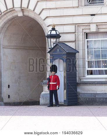 LONDON UNITED KINGDOM - JUNE 21 2017 : Buckingham Palace with Royal guards on the guard. Palace is the London residence and administrative headquarters of the reigning monarch of the United Kingdom