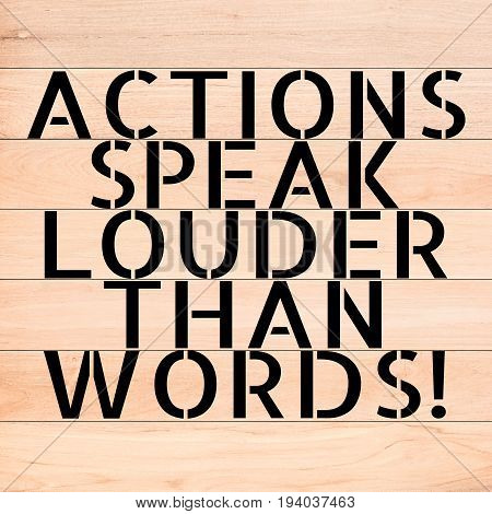 ACTIONS SPEAK LOUDER THAN WORDS text on wood background