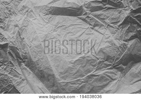 Rough white paper texture. Crumpled paper texture and background. Close up view of wrinkled white texture made with paper. Abstract texture and background for designers.