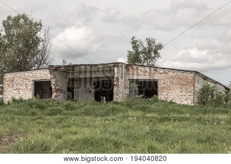 The destroyed building in the wood. The thrown disbanded military unit. Russia