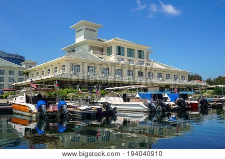 Labuan,Malaysia-May 1,2017:Waterfront Labuan Hotel with yachts in the yacht club in Labuan island,Malaysia.This hotel is perfectly located for both business and leisure guests in Labuan.