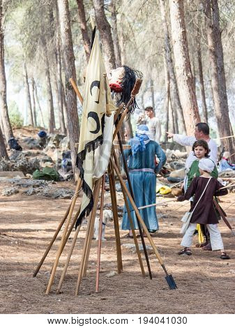 Tiberias Israel July 01 2017 : Flag of Saladin spears and mock-up of the severed head in the camp of the participants of the reconstruction of Horns of Hattin battle in 1187 near TIberias Israel