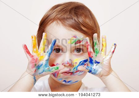 Colorful painted hands in a beautiful young girl (art childhood color concept)