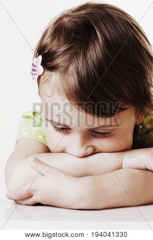 Portrait of little cute child girl expressing sadness (Gestures body language facial expressions depression crisis concept)