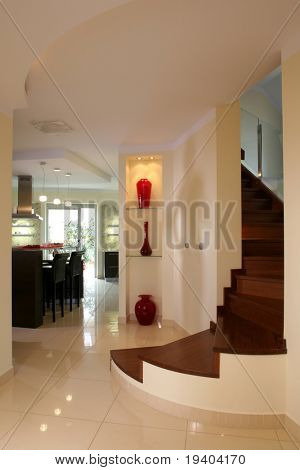 A view of an elegant, curving interior stairway in a home or luxury apartment.