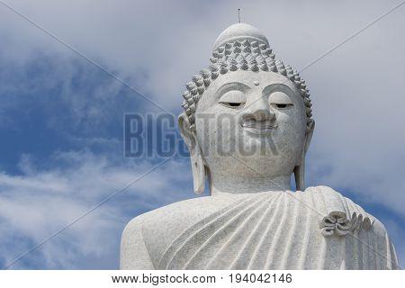 Big Budda in Phuket Island Thailand with sky background