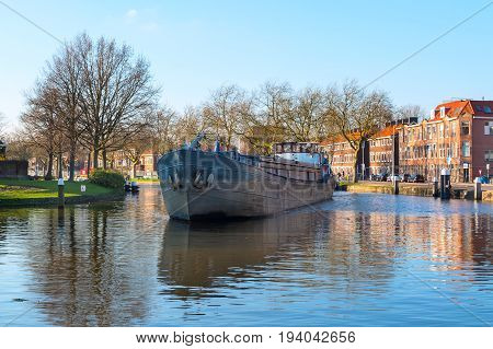 Ship at the canal of Delft, Netherlands, Holland and dutch houses