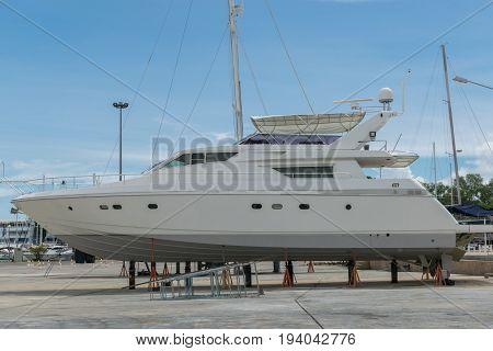 Motor Yacht waiting for repair on the shipyard in Phuket Thailand