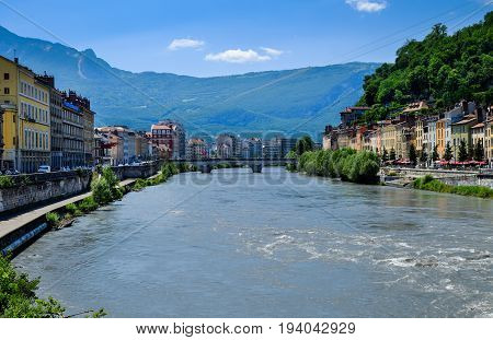 Picturesque view on Grenoble city and bridges on Isere river