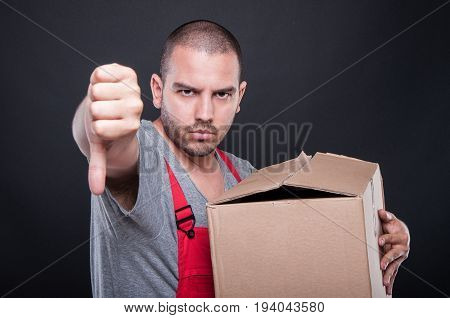 Upset Mover Man Holding Box Showing Thumb Down