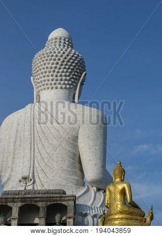 big Buddha with blue sky and gold Buddha statue in PhuketThailand