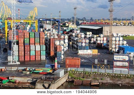 St. Petersburg, Russia - June 25 2017: freight shipping containers and gas tanks at the docks. in import export and business logistic. Trade Port, Ship cargo to harbor.
