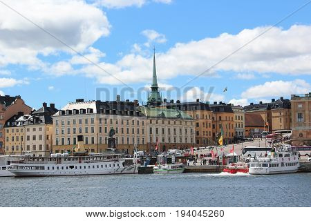 Stockholm, Sweden- 27 Jun 2017: Scenic panorama of the Old Town (Gamla Stan) pier, Cathedral, tour boats and old houses architecture.
