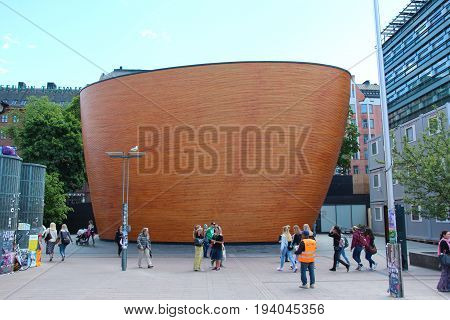 Helsinki, Finland - 28 Jun 2017: The famous wooden chapel of silence in the capital of Suomi on the commercial area in Kampi.