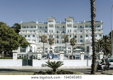MALAGA, SPAIN - June, 29 2017: Gran Hotel Miramar facade in a sunny morning. The Gran Hotel Miramar is the biggest 5 stars hotel in the city of Malaga, and it was reformed and reopened in 2017.