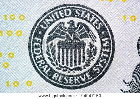 Close up of FEDERAL RESERVE SYSTEM seal on US dollar bill (banknote)