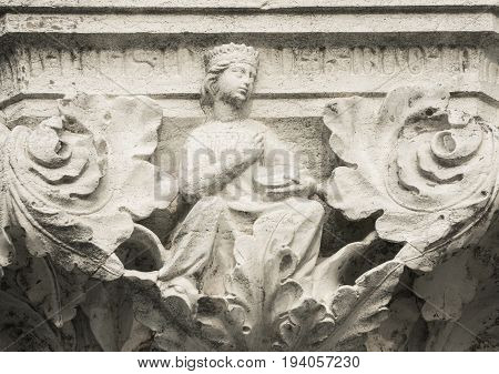 Queen Princess or Damsel with tambourine ancient medieval relief on Venice Doge Palace column