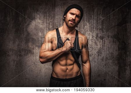 Athlete training in a gym portrait on a wall - Functional training workout