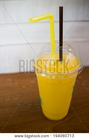 Delicious mango smoothies on wooden table stock photo