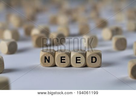 Need - Cube With Letters, Sign With Wooden Cubes