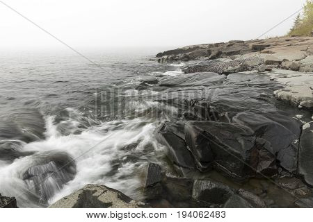 Lake Superior rocky shore on a foggy day.