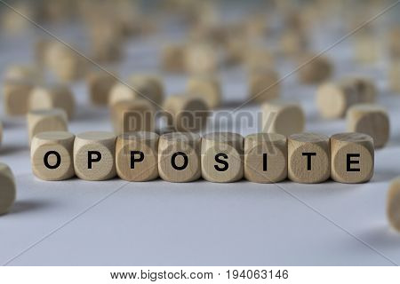 Opposite - Cube With Letters, Sign With Wooden Cubes