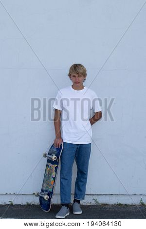 Cute Teenager Boy Stand Up With Skate Board On City