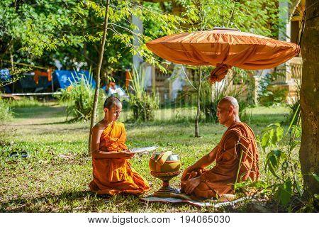 KRABI THAILAND - MAY 2 2015: Novice monk chanting in front of senior monk in Lanta island of Krabi Thailand