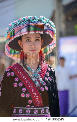 CHIANGMAI THAILAND - JANUARY 25 2015: Hill Indigenous girl with local traditional costume in parade of 22nd Traditional Skirt Fabric and The Indigenous Product and Culture Festival in Mae Chaem Chiangmai Thailand