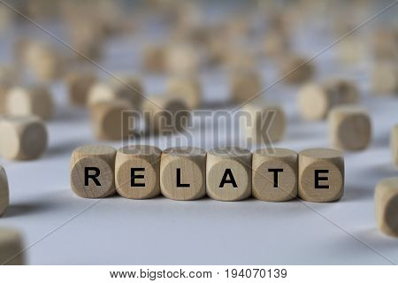 Relate - Cube With Letters, Sign With Wooden Cubes